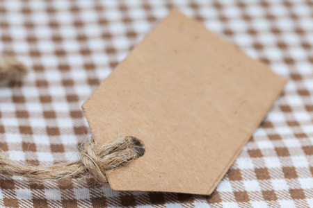 close up of blank brown paper price tag