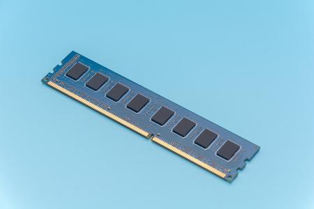 Stick of computer random access memory (RAM) on blue background