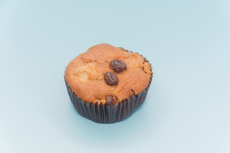 close up of Banana Cup Cakes with raisin topping