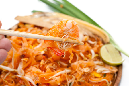 chopstick and pad thai noodle on plate
