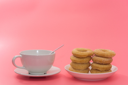 Fried Donuts with sugar topping on pink background