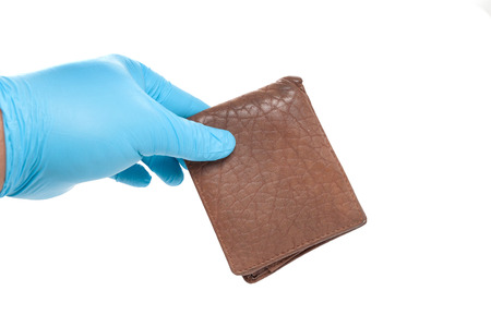 hand in blue glove holding a wallet Stock Photo