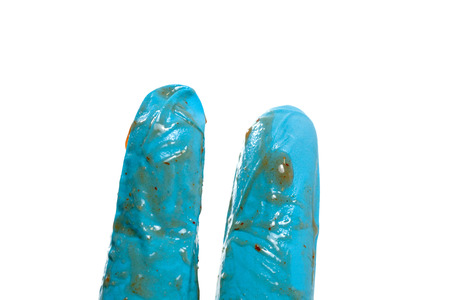 hand in blue glove with tomato sauce
