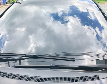 reflect of the sky on the windshield car