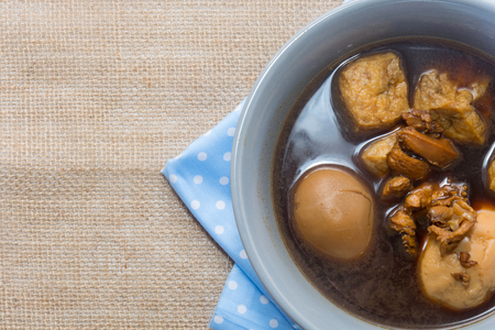 Eggs boiled stewed in the gravy on white background Stock Photo