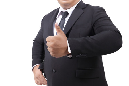 Businessman In a Suit Giving Thumbs Up Stock Photo