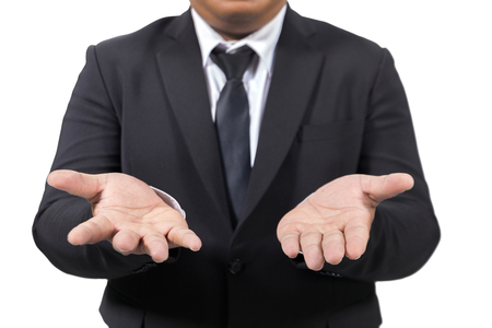 businessman in a suit opening palm hands Stock Photo
