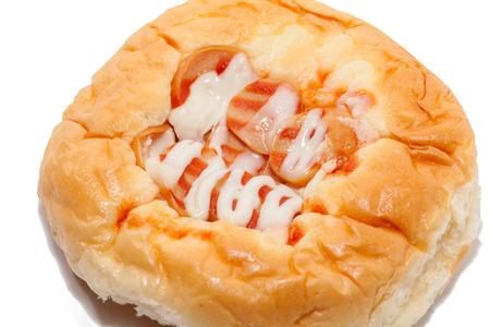 close up of sausage bun with sauce