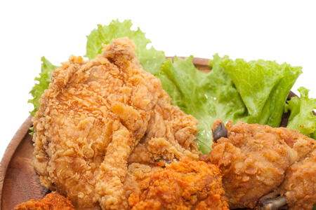 close up of fried chickens on wooden plate Stock Photo