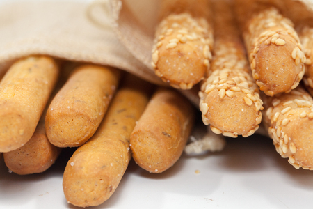 close up of bread stick on sack