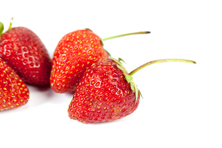 Pile of strawberry isolated on white background