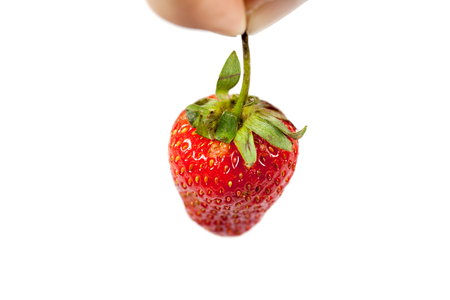 Hand pick up strawberry isolated on white Stock fotó