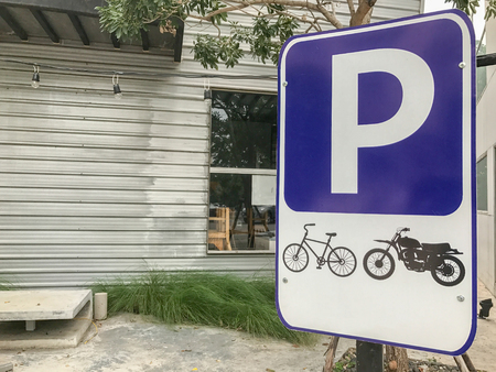 motorcycle parking spot sign in front of store in thailand