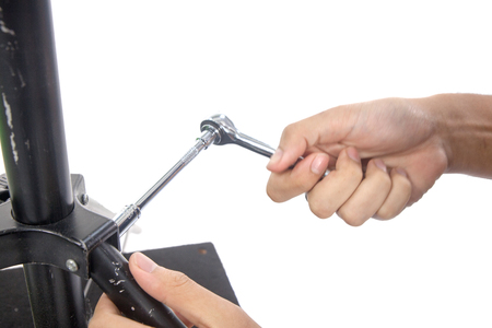 close up of Hand with Ratchet spanner on white background