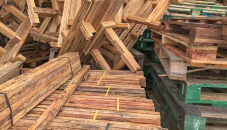 row stack of wood in storage warehouse