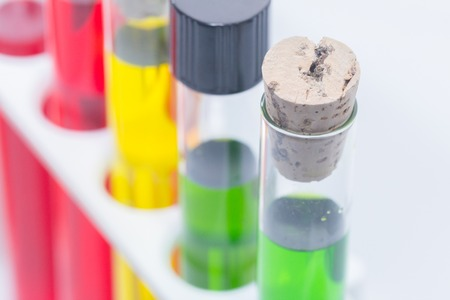 close up of colorful liquid in test tubes on rack