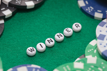 word winner with poker chips and money, gambling concept