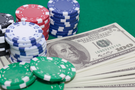 pile of poker chips and money, gambling concept Stock Photo