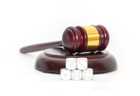 Judge Gavel with dice on white background