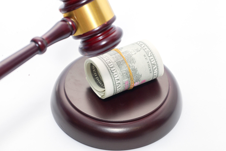 Judge Gavel with banknote on white background Stock Photo