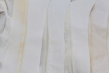 dirt stain of shirt on white background 版權商用圖片