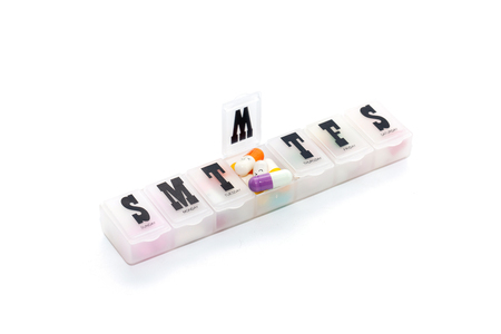 colorful pill in the box on white background