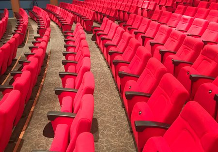 row of red seat in auditorium hall