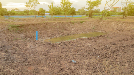 pond under construction with dried soil for farm