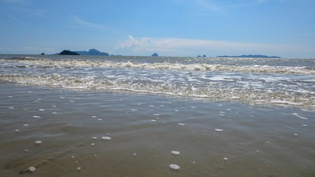 sea water foam on the beach in a sunny day of summer at Pak Meng Beach Trang province,Thailand 版權商用圖片