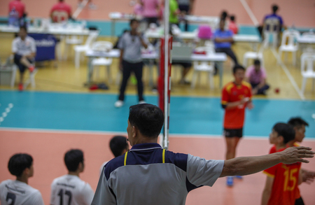 volleyball match and male referee at thailand