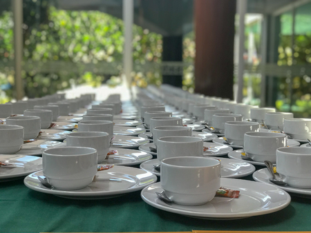 row of white coffee cup at hotel