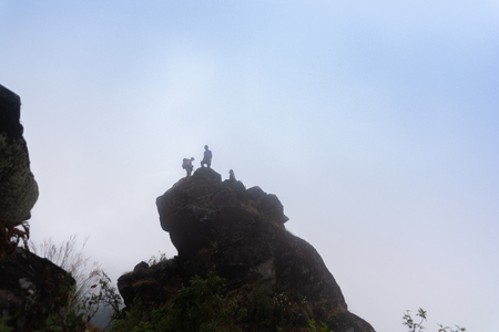 silhouette of tourist group on high cliff rock in mon jong doi at Chaing mai, Thailand