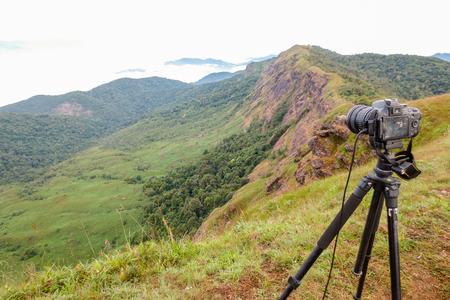 Camera on tripod Photographers take photo at Doi Mon Jong, a popular mountain near Chiang Mai, Thailand