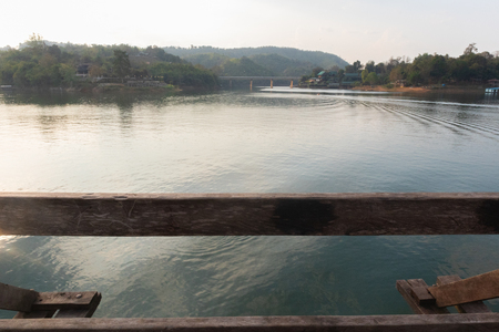 landscape scene Wooden Mon Bridge at kanchanaburi, Thailand 免版税图像