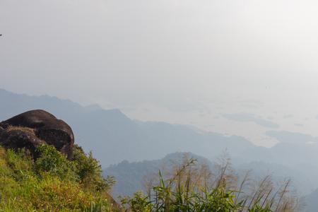 big stone on top of the mountain and tree at thong pha phum national park, kanjanaburi, Thailand