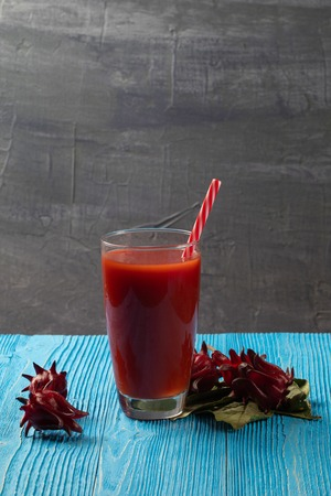 close up of Roselle juice on wooden blue background