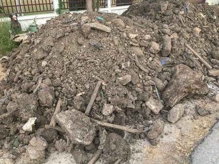 pile of dirt near the wall for construction