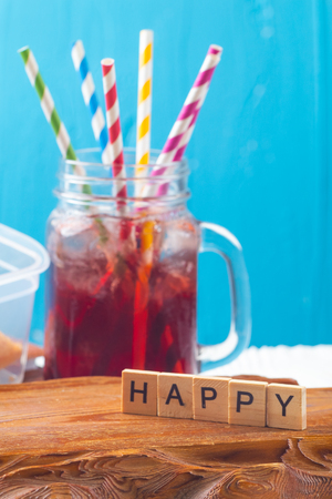 close up of happy text sign with juice Фото со стока - 120853359