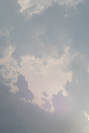 the sun hide behind grey cloud at evening Stock Photo