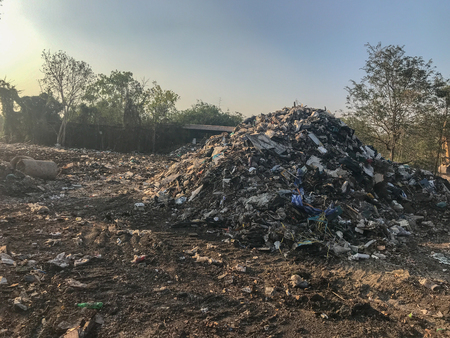 pile of old dirty garbage in construction site