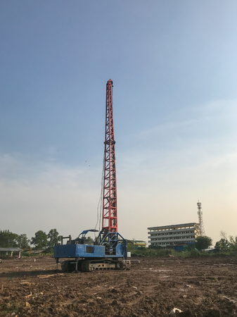 Hydraulic pile drilling machines at construction site