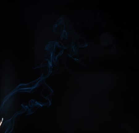 Abstract smoke of joss stickon black background