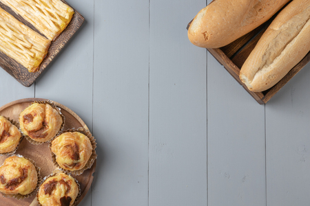 flat lay of variety of bakery and danish shredded pork on wooden board