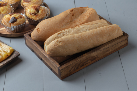close up of bakery and bread on wooden board