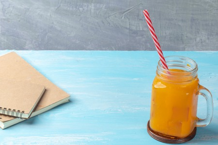 close up of iced orange juice in glass