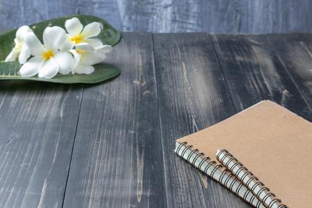 close up of notebook and Plumeria flower Reklamní fotografie