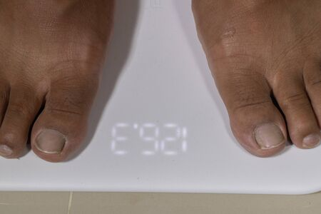 close up of man feet and digital smart scale Stock Photo