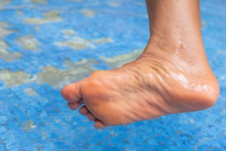 close up of old people feet at hot spring 免版税图像