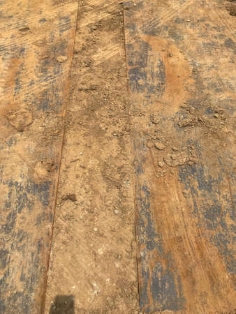 close up of metal sheet on dirt construction site