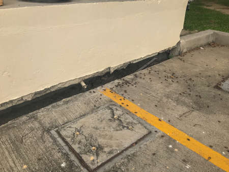 close up of Land subsidence gap between hole and building